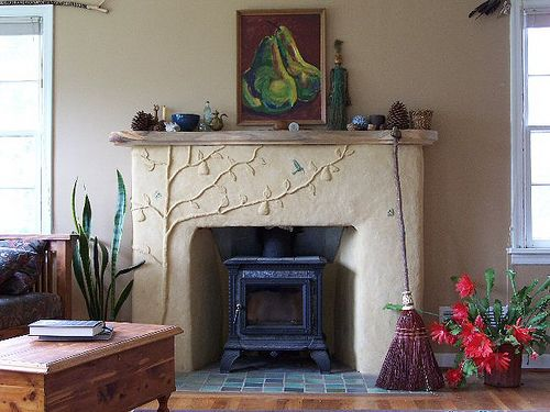 Earthen plaster over brick Living Room Fireplace Remodel by Artisan Builders Collective, via Flickr