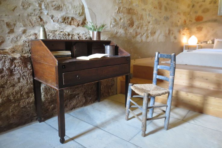 An old wooden desk with a chair in a Double Bedroom