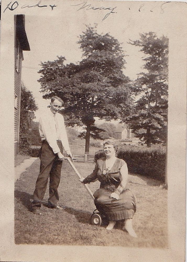 Vintage Antique Photograph Woman Sitting on Lawn Mower that Man is Pushing