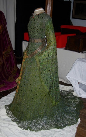"""Ellen Terry wore this """"beetle wing"""" dress for an 1888 performance of 'Macbeth' at the Lyceum Theatre. The dress, designed by Alice Comyns Carr, is adorned with real wings shed naturally by the jewel beetle of Southeast Asia. Carr, who worked closely with Terry on her costumes, wrote that the dress should look """"like soft chain armour… [and] give the appearance of the scales of a serpent""""."""