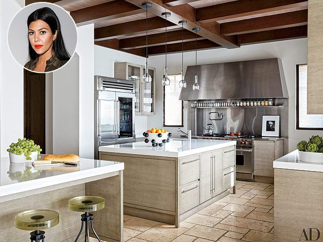 Look Inside These Gorgeous Celebrity Kitchens | KOURTNEY KARDASHIAN | The reality star's pristine kitchen in her Calabasas home is equipped with limestone floors, pendant lights, and, of course, top-of-the-line appliances.