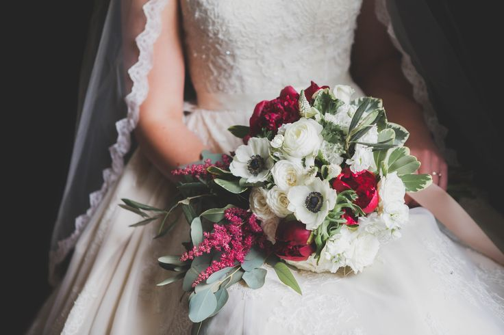 Elegant spring bridal bouquet created by Peony House Floral Studio.  Peonies, anemone, olive branch, ranunculus, veronica, burgundy astilbe, white spray roses...