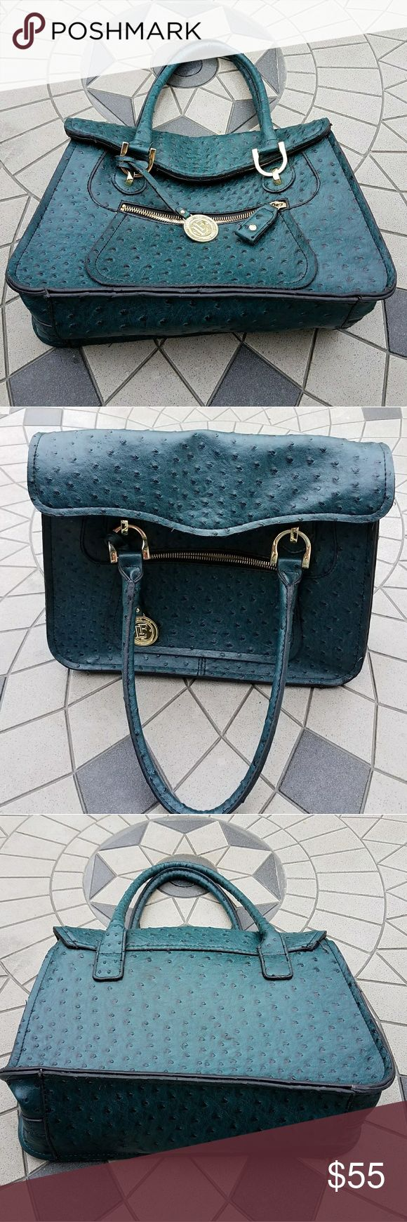 """London Fog: Emerald Green Pebbled Leather Handbag NWOT: Deep, emerald green pebbled leather handbag with gold tone accent hardware. The exterior has the logo hanging emblem, a zippered satin lined slip pocket with flap magnetic snap closure, and durable loop handles. The satin lined interior has a divided zippered compartment with the back side having a zippered and slip pockets, and the front side has two slip pockets. Excellent condition with no stains or tears.  Approx. Dims: 14.5"""" x 5"""" x…"""