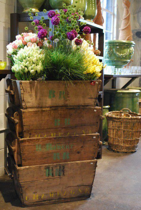 Love rustic container with lush mixture of flowers