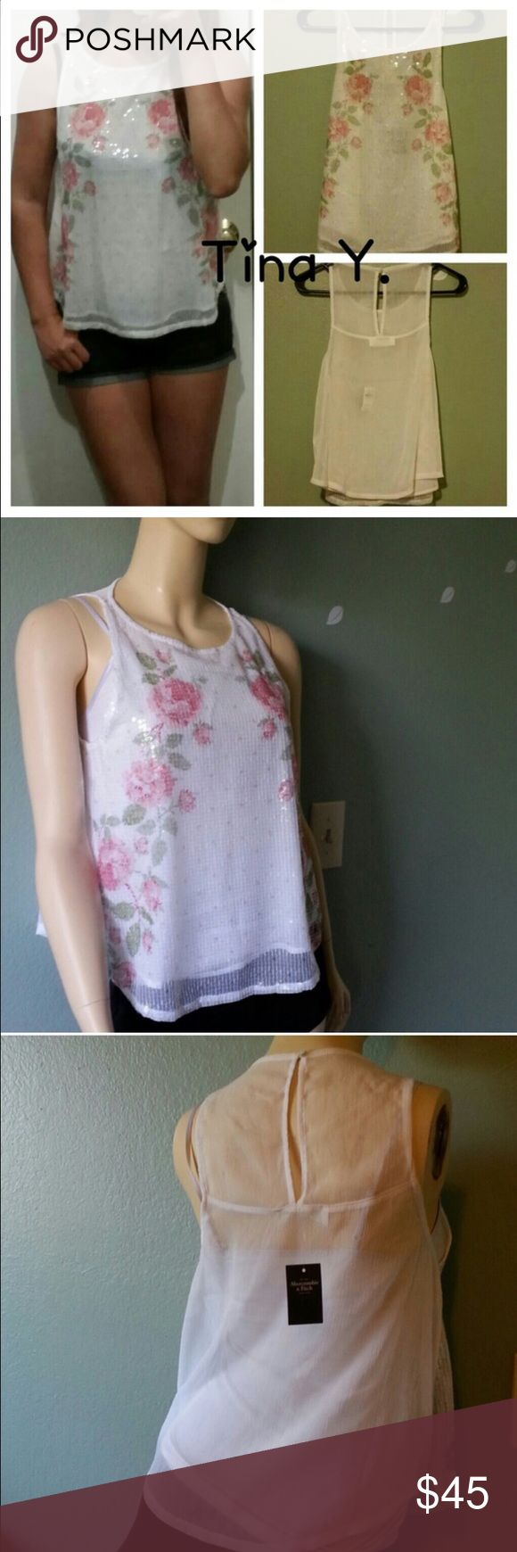 New Abercrombie and Fitch • Sequin Floral Top Beautiful and bold sequin floral! What women does not like hearing how beautiful she is and how much her clothes compliment her? This top is sure to make anyone stand out! Abercrombie & Fitch Tops Tank Tops