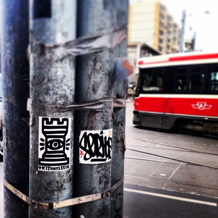 The streets are watching. Toronto street car TTC on queen st. KIZ and Legin.