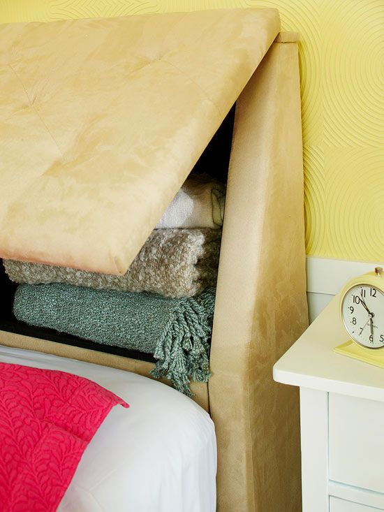 Storage-Packed Headboard. Small bedrooms necessitate creative storage solutions. Make the most of your limited space with a storage-laden headboard. This headboard features padded lift-up panels that shield from view everything from extra blankets to cozy sweaters. Plus, when the panels are closed, the ledge on top of the headboard offers a place to set bedtime necessities and decorative items.