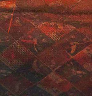 """In order to study the lining, we took a screen capture of the best available shot to see the design pattern.  The pattern is aged and faded with symbols of a bird that are rotated in different directions in every square.  There are also color changes and gradients to the coloring plus an overlay of what appears to be """"thread bare"""" sections.  To create the lining fabric this was definitely a challenge. Bbeauty Designs"""