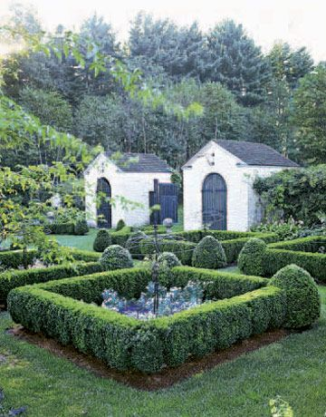 flanked by twin renaissance inspired garden sheds the entryway features boxwood edged parterres as a visual appetizer before vegetables galore