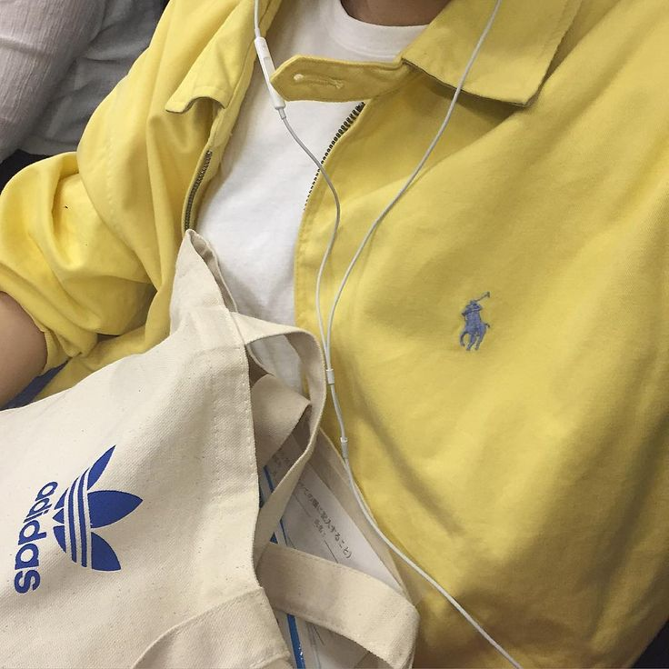 white t-shirt, yellow ralph lauren jacket with blue polo symbol, and tan reusable grocery store bag with blue adidas symbol