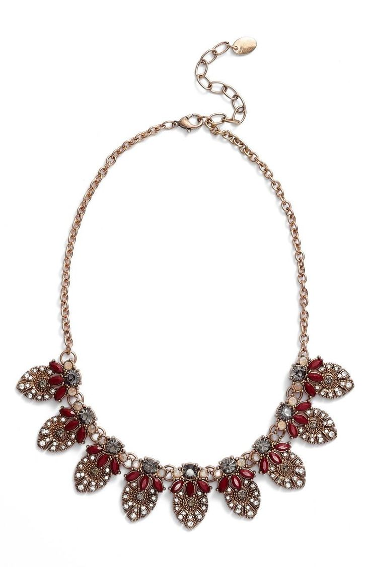 Make a vintage-chic statement with this stunning bib necklace featuring ornate medallions set with sparkling crystals and burnished-metal beadwork.
