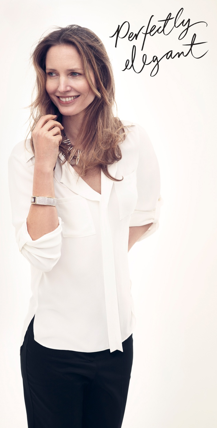 A white blouse and black trousers are all you need for a smart office outfit.