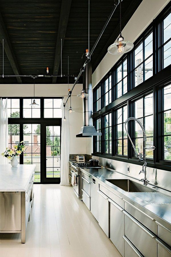 floor to ceiling + modern farmhouse. stainless steel or polish concrete counter tops. industrial chef's kitchen