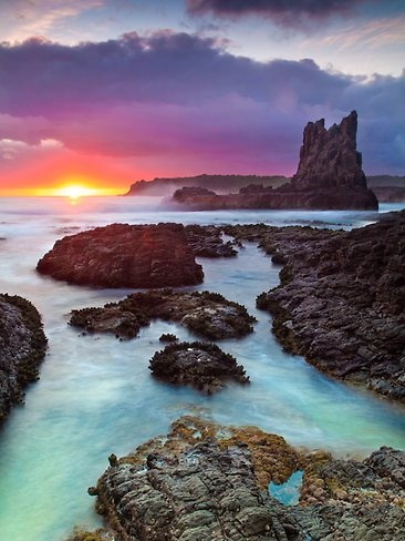 This sunrise shot of Cathedral Rocks in the Kiama region is a couple of hours from Sydney. Picture: Marc Lynch