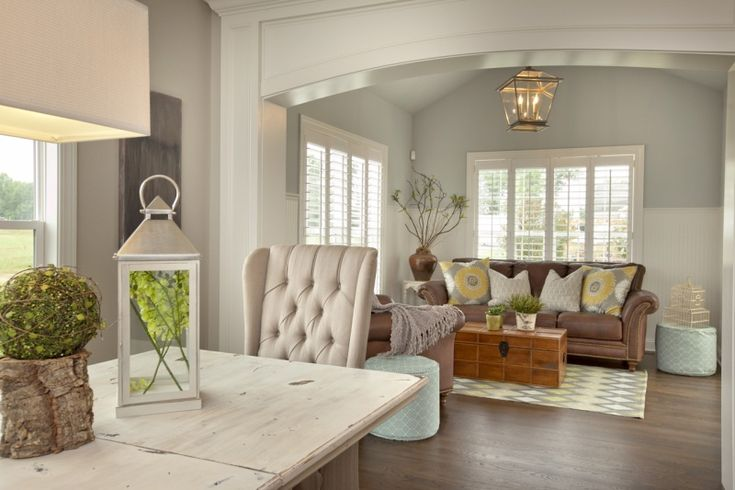 Casual Dining Room and Hearth Room with Cathedral Ceilings by 3 Pillar Homes.