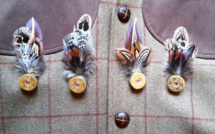 pheasant feather with shotgun cartridge. pin, buttonhole, hatpin/ brooch http://countrycraftybits.co.uk/