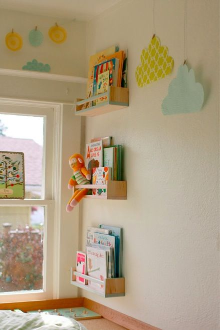 Another gorgeous hack of Ikea spice racks into bookshelves for a child's room