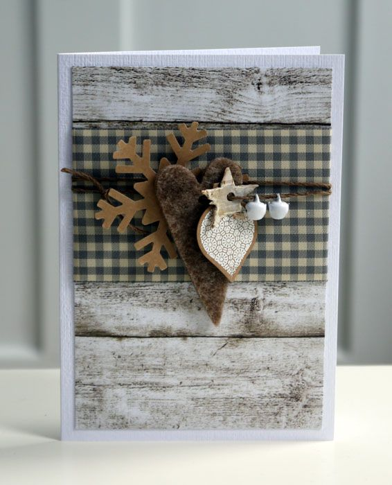 I like the tiny white jingle bells dangling with the star love everything of this card