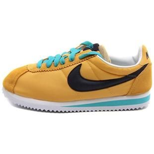 black and yellow nike cortez