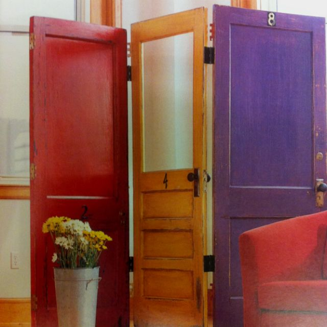 Love this idea for making a colorful room divider out of three old doors and painting them fun colors. What an awesome idea for a shared kid's room or to divide work and family space in a living room.