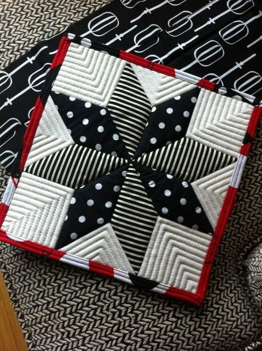 card idea/inspiration: Quilting: Lemoyne Star Potholder ... this would make an awesome quilt  card ... some hand embossing and patterned papers ...