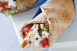 Greek Chicken in a Pita Wrap-- could substitute the dressing for tzatziki, and of course any feta would work