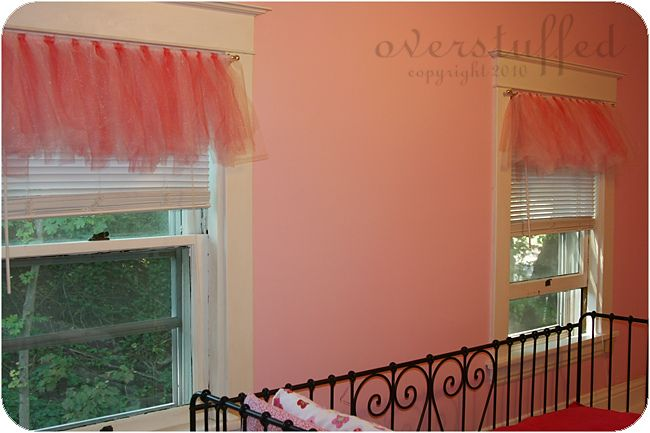 Use tulle tied on curtain rods to make valances in a little girl's room,