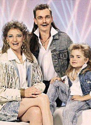 matching mullets!@Katie Roberson i think in the future you and haley and your future child should take a picture just like this!