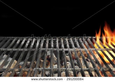 Close-up Of Flaming BBQ Charcoal Grill Isolated On Black Background - stock photo