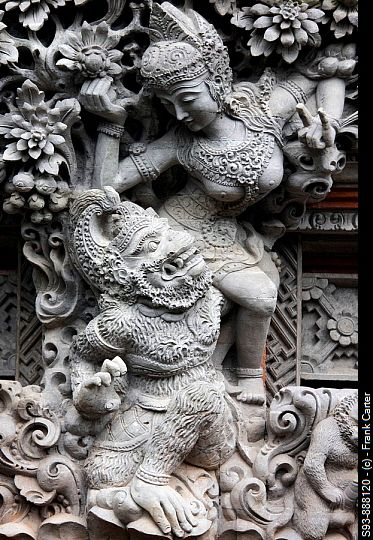 A sculpture of Balinese Hindu figures in Ubud, Ball. Balinese stone carvers achieve amazing results.