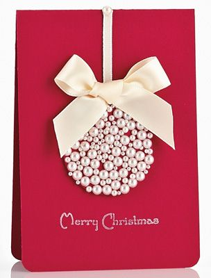 Choose a vibrant color for your card base, glue pearlescent beads in the shape of an ornament.  The beads can be a single color such as this, or a variety of colors. The ribbon also can match or complement the bead color.  A simple stamped message complete this elegant card.