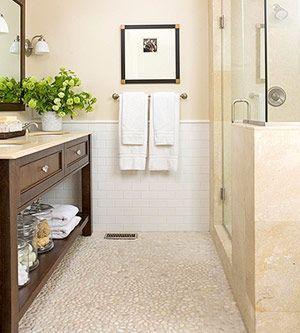 Neutral bathroom; pebble floor