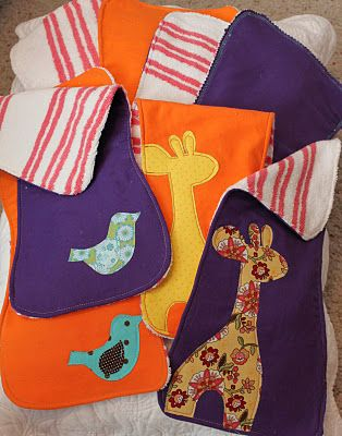 Baby burp cloths, I love them. This lady has a great idea.  She bought a full size bath towel on clearance and cut it to the size she needed.  Seems much cheaper than buy prefolded diapers.  Terry cloth is really absorbent too, right?