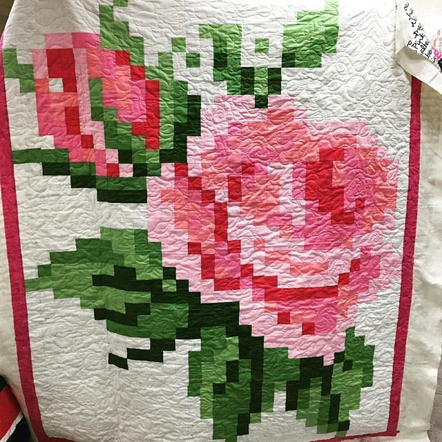 Look at this Pixelated Rose quilt one of our customers made!  The pattern is free from Riley Blake's website, but the fabric, Confetti Cottons, you get from us!