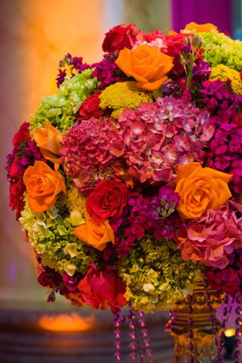 Love these colors together in a floral arrangement. The Green, orange and pink work so beautifully together,