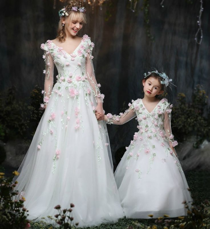 Mommy & Me Dress--Made To Order - High Quality V-neck Long Sleeve Floor Length Floral Applique Zipper & Lace Up Mother Daughter Matching Gown These matching mother daughter dresses are perfect for photo shoot, wedding, birthday or any occasion Material: Organza, cotton, tulle mesh, soft polyester fiber Color: White Please do compare your  little girl measurements with our size chart below before deciding her size. #momandmematchingoutifts #motherdaughtermatchinggown