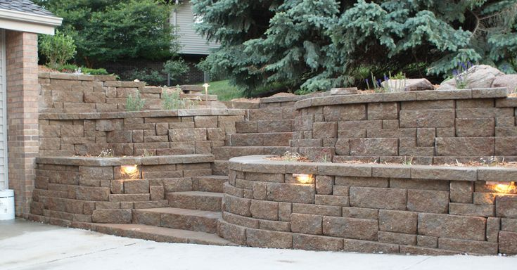55 best retaining walls images on pinterest backyard for Block wall landscape design