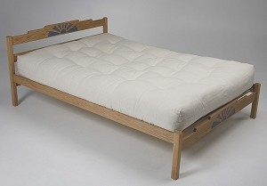 Salsa Platform Bed. Made in Albuquerque, NM the Salsa captures the feel of the southwest with a sunburst design carved into the headboard and footboard with a dusty blue color added to the design.