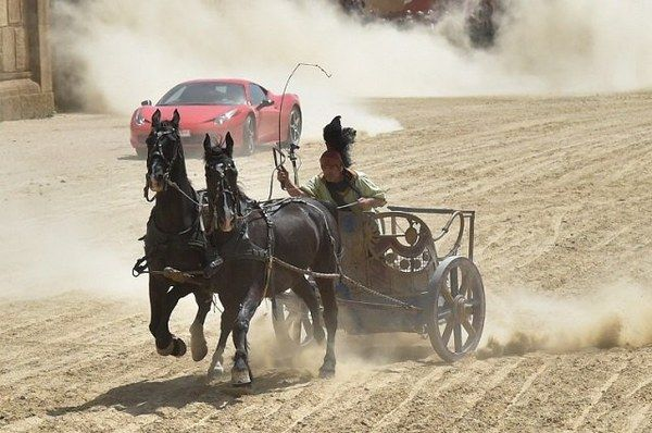 A horse-drawn chariot raced a Ferrari on a dirt track in Rome rightrelevance.com/search/article…