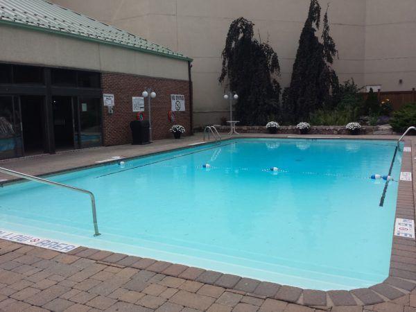 Heated outdoor swimming pool at Holiday Inn Niagara Falls By the Falls in Niagara Falls, Ontario, Canada