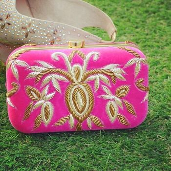 Pink clutch with gold & white work