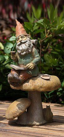 """13"""" Decorative Gnome Sitting on a Mushroom Outdoor Patio Garden Figure by CC Outdoor Living. $29.99. Gnomes are known for their good stories, so gather around for a good readSitting upon a mushroom, with a cup in his hand, an open book on his lap, he is ready for story timeFor indoor/outdoor useDimensions: 13""""H x 8""""W x 5""""DMaterial(s): resin. Save 14% Off!"""