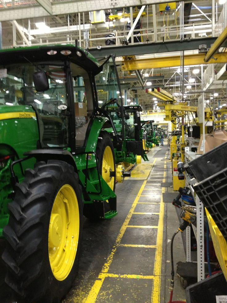John Deere tractors rolling off the factory line.