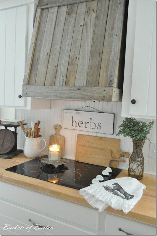 Reclaimed wood- great ideas including a rustic stove hood