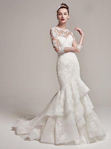 Sottero and Midgley - moriah, Lace motifs add sophisticated elegance to this fit and flare wedding dress, featuring a strapless sweetheart neckline and layered Fallow organza skirt and train. Complete with crystal buttons over zipper and inner corset closure. Also available, an illusion lace bodysuit with three-quarter length sleeves. Bodysuit sold separately.