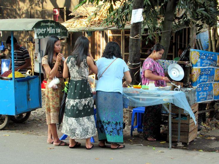 A night market sets up along Wai Bar Gi Street in a western suburb of Yangon, Myanmar (Burma).