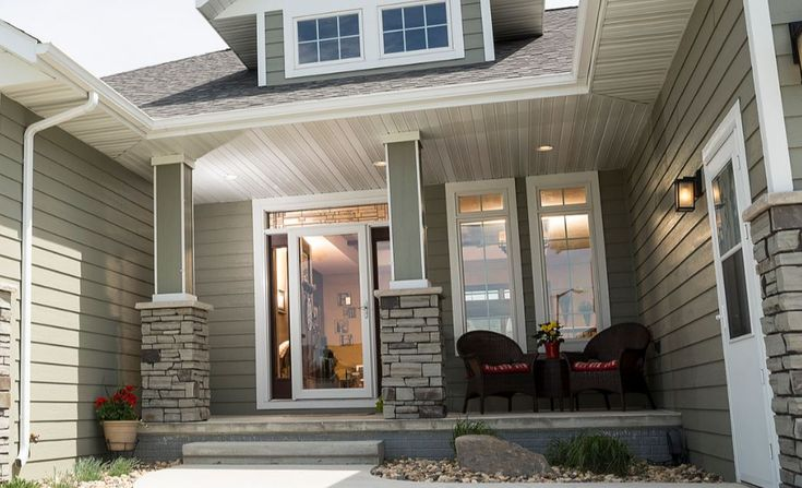 A storm door looks great on this high end home! The Larson Storm Door is a full view, which is great for enjoying the view outside!