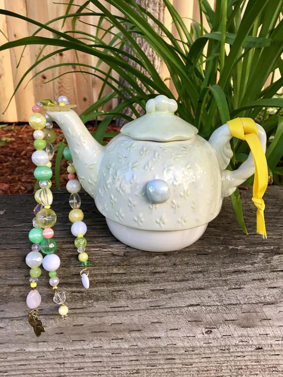 Upcycled ceramic tea pot mobile and wind chime, a whimsical garden decoration and home decor accent!