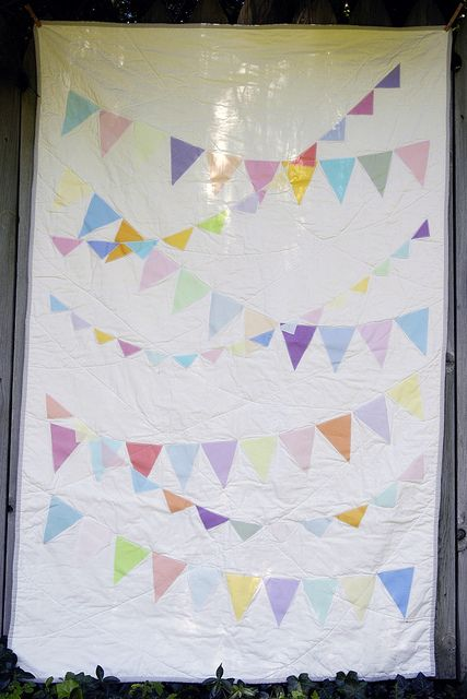 Pennants on a quilt- be sure to click the link! The back is super cute too. (pinwheels!)
