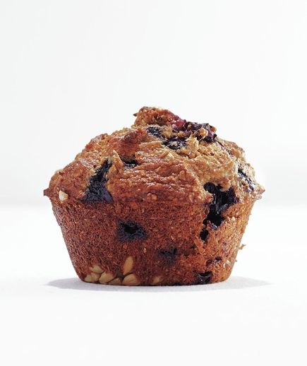 Banana-Blueberry Bran Muffin with whole-wheat flower and sunflower seeds. Part of a Real Simple list of recipes for a more balanced diet.